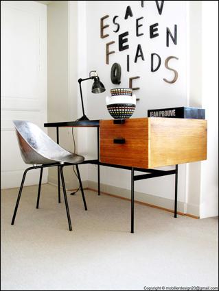 Ambiance design avec mobilier Guariche et Paulin
